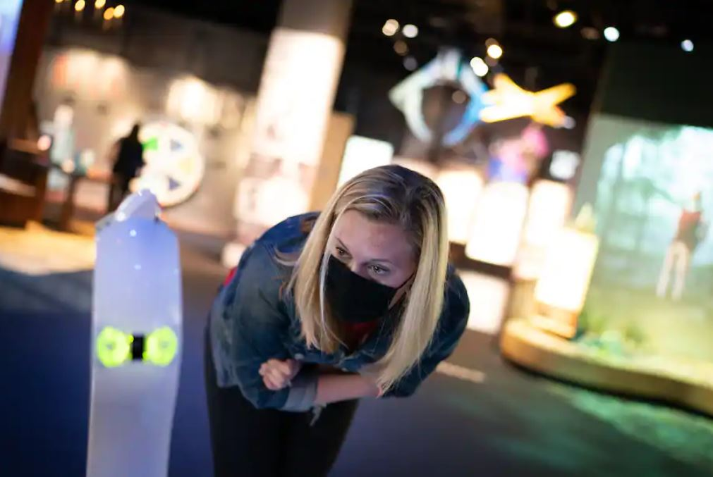 Lucy Stirn, a Spy Museum employee, talks to a hospitalized child who is using the robot to visit the museum. (Sarah L. Voisin/The Washington Post)
