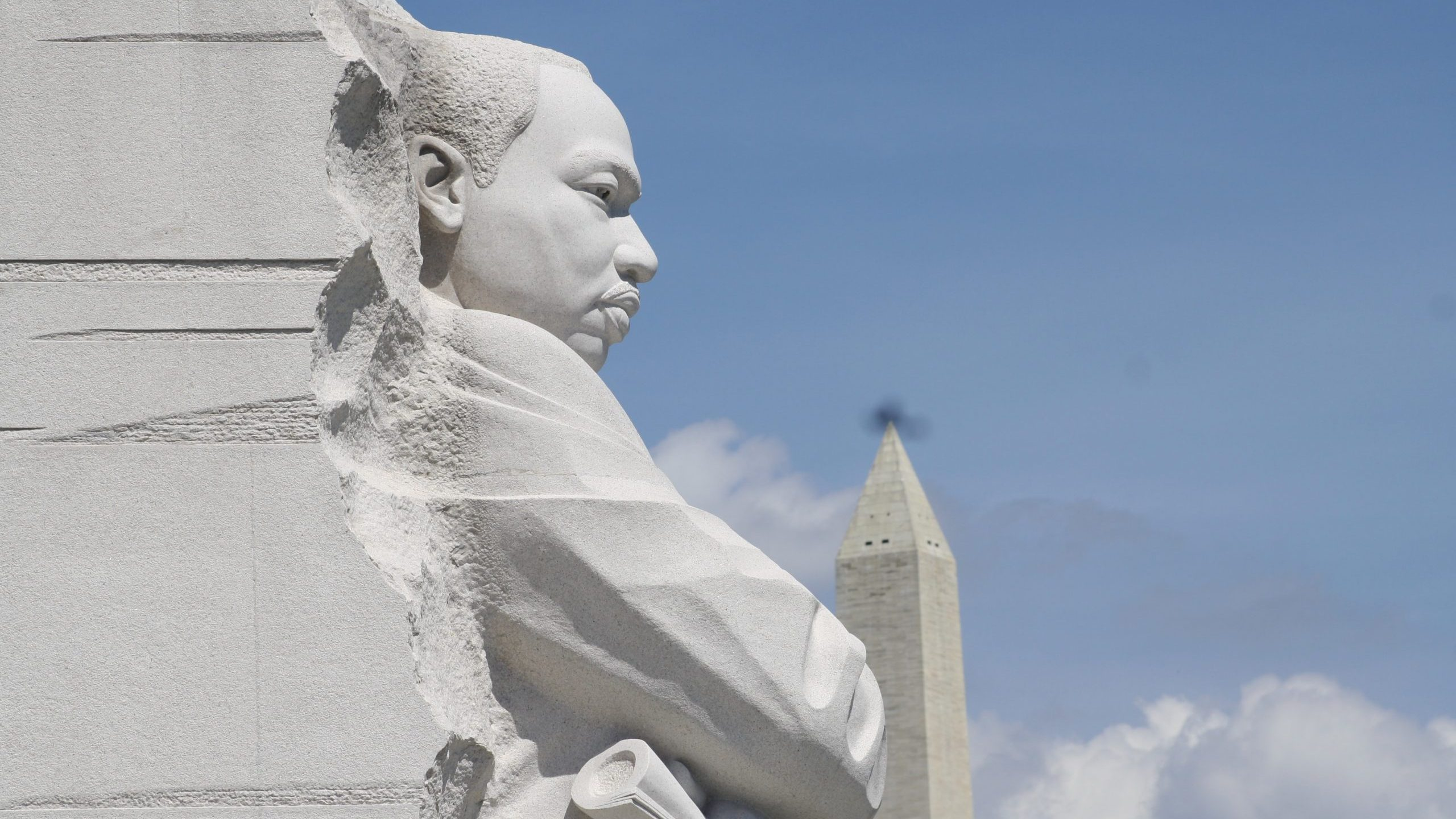 A view of the Martin Luther King Jr. memorial with the Washington Monument in the background