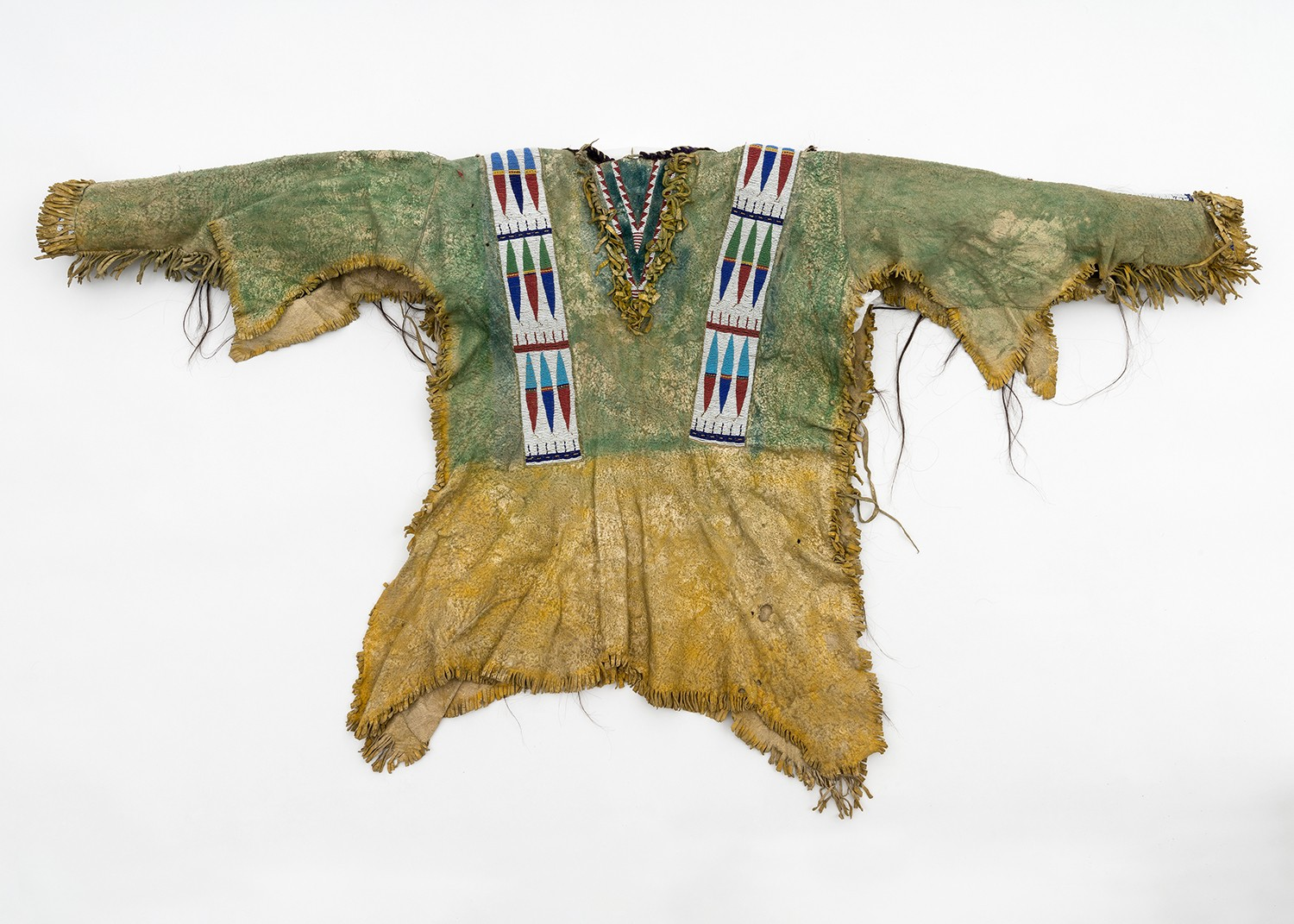 Leather shirt with beaded rows on the shoulders.