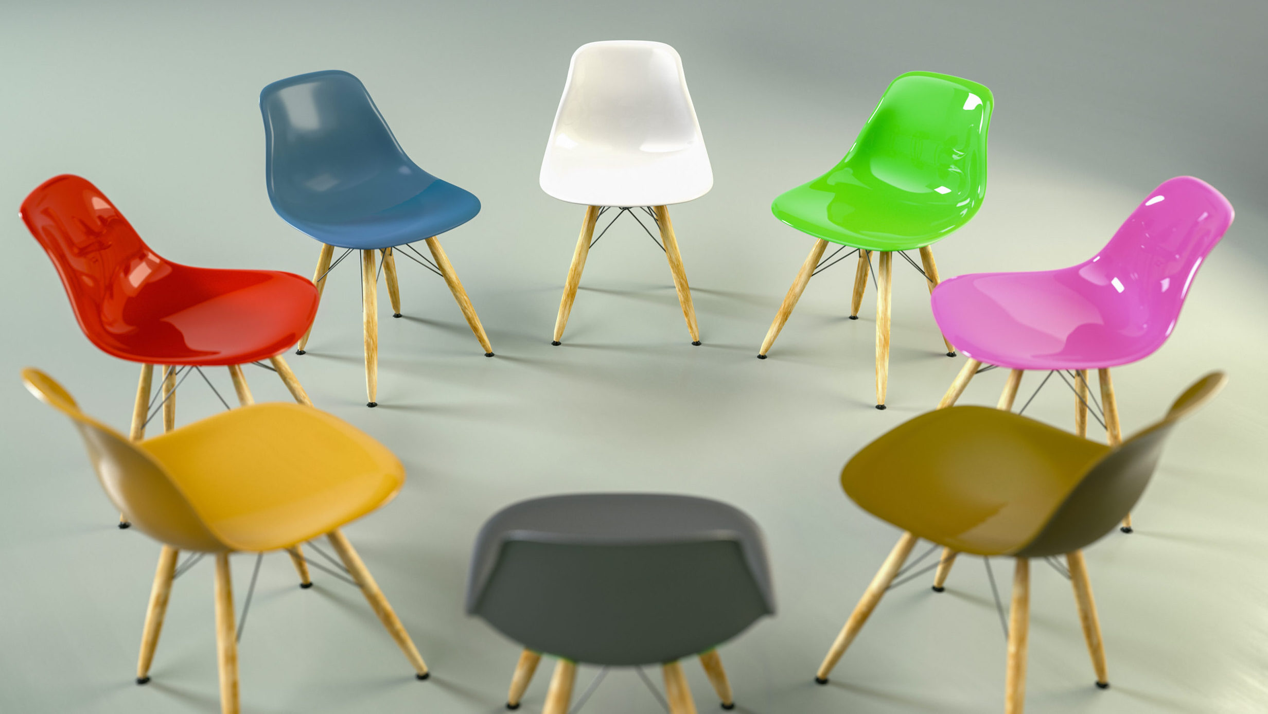 A circle of chairs in different colors