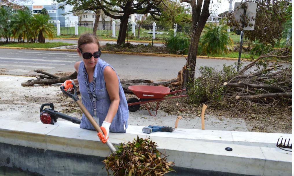 Alejandra Peña-Gutiérrez, executive director of the Museo de Arte de Ponce, works to clean up the museum grounds after Hurricane Maria in 2017. (Museo de Arte de Ponce)