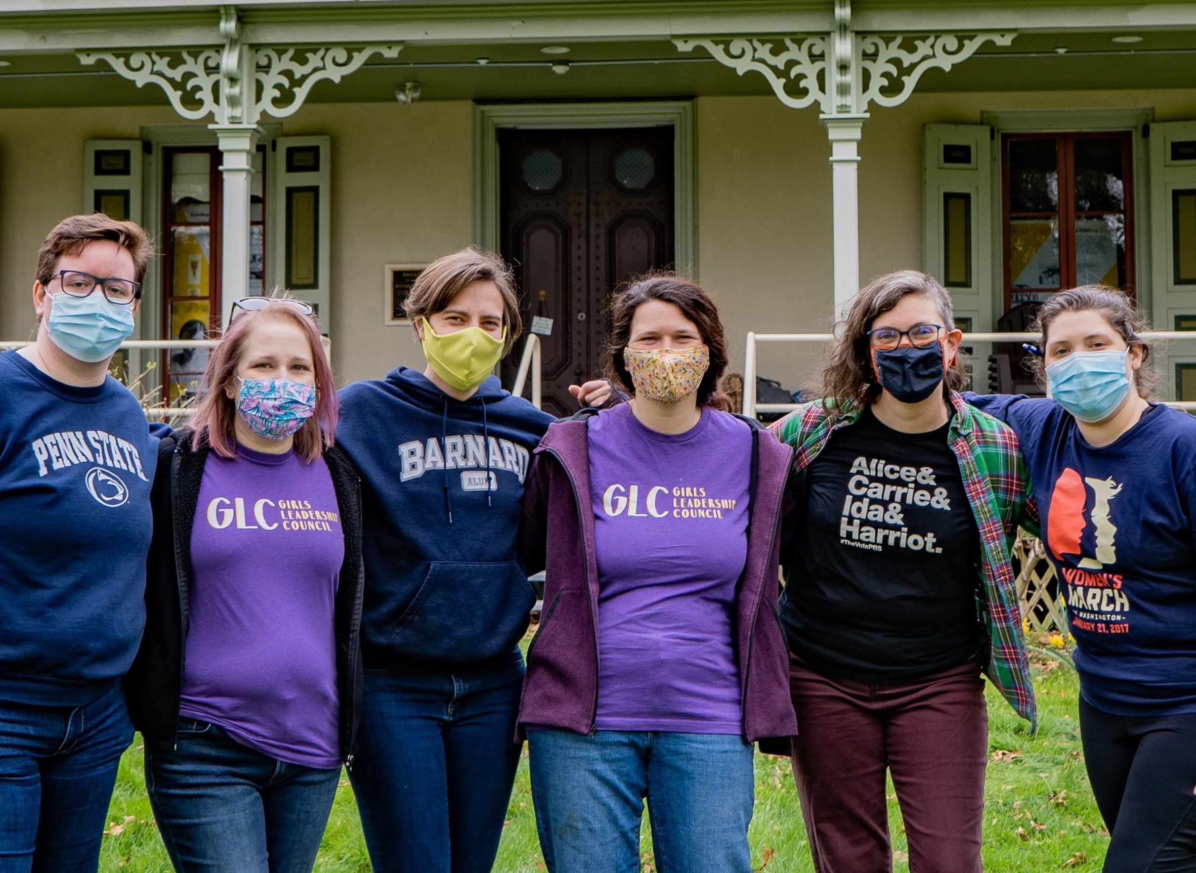 Several members of the Alice Paul Institute staff in front of the organization's headquarters in Mt. Laurel, NJ.