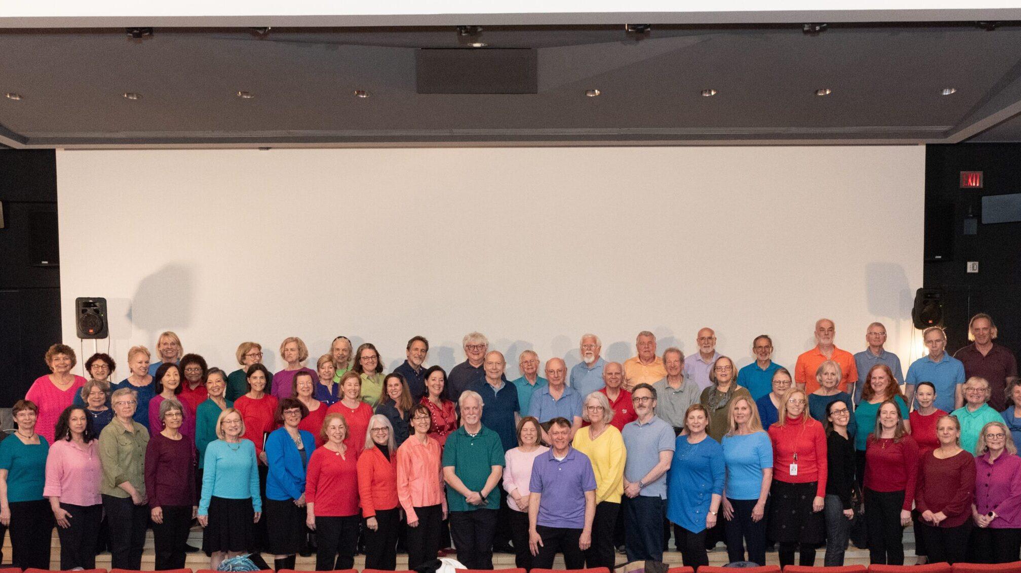 A group portrait of senior participants wearing colorful shirts